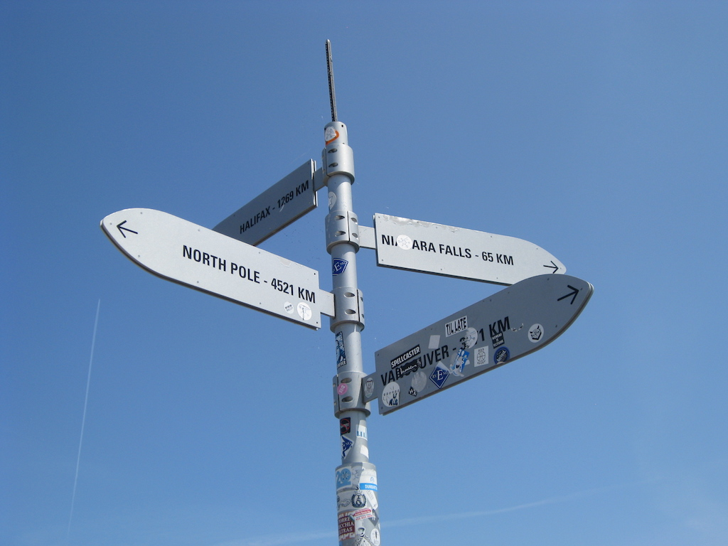 Directional sign at the pier on Centre Island