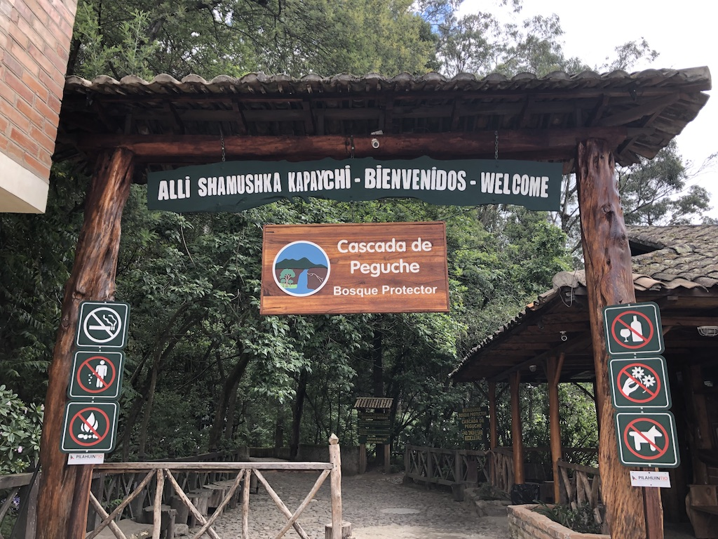 Welcome sign to Peguche waterfall