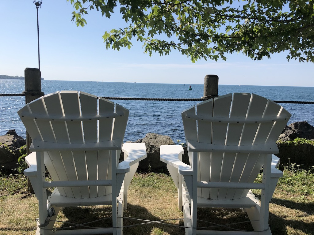 Muskoka chairs and lake view