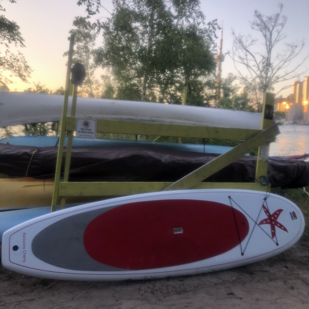 My cherry red SUP board...Love the starfish!