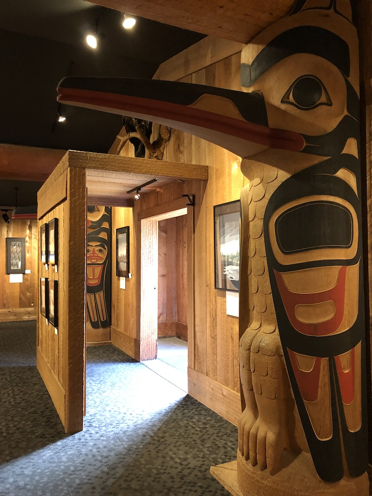 Beautiful wood carvings at the doors inside Roy Henry Vickers Gallery.