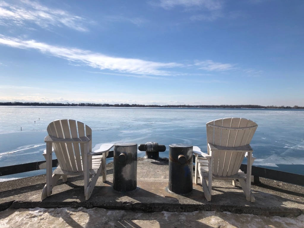 White Muskoka chairs with a view.