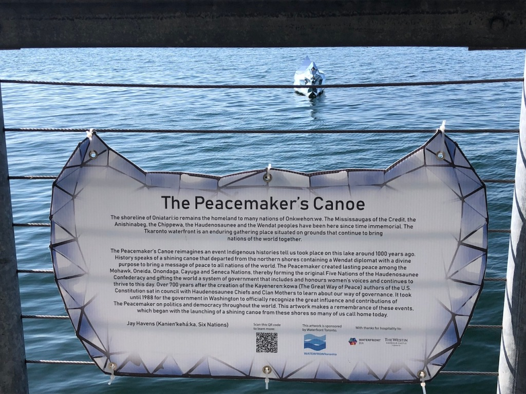 The Peacemaker's Canoe info board.