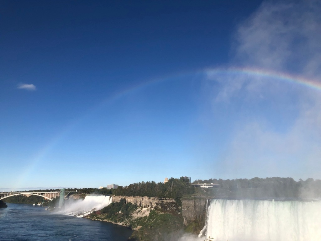 Rainbow arc across Niagara Falls to the Rainbow Bridge